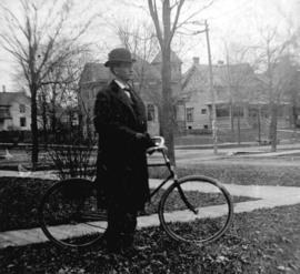 [Arthur Baker with bicycle]