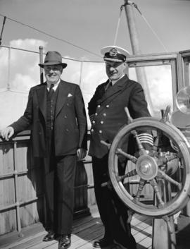 "[A.C. Egan, Assistant Comptroller C.N.R. and Captain Nedden on the S.S. ""Prince George""]"