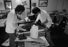 Jim Wong-Chu leading a silk-screening session for Pender Guy