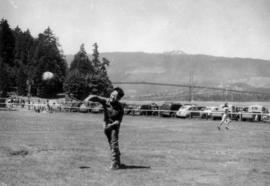 Boy playing ball at Lumberman's Arch picnic area in Stanley Park