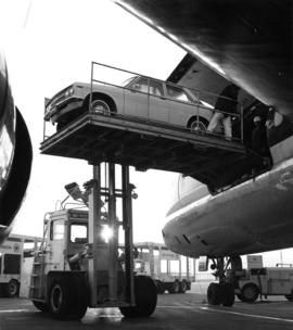 Loading Datsun 1600 Sedan onto a Canadian Pacific Air Lines carrier leaving from Vancouver to Tor...