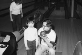 Hayne Wai and child at bowling alley