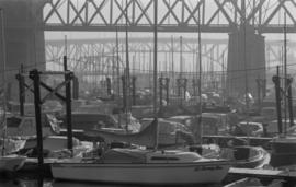 Boats moored at marina under Burrard Bridge