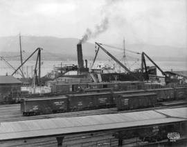CPR Shed Wharves [CPR freighter and railcars at wharf]