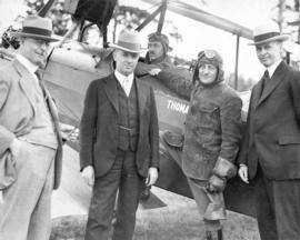 [Mayor L.D. Taylor, Mayor Pendry, Stimpson and Mayor Edwards standing in front of airplane after ...