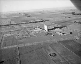 Air view of factory site, looking south