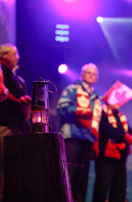 Paralympic flame lantern with Dignitaries behind at Maple Ridge's Community Celebration in B...