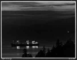 Night anchorage [ship in harbour at night]