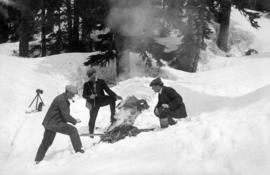 [James Crookall and others building a fire in the snow]