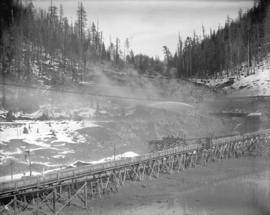 [Partially constructed Coquitlam Dam, showing flumes and hydraulic monitor sluicing material from...