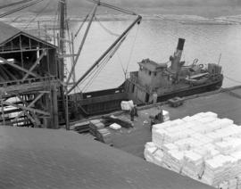 [Boat being loaded with paper products at the Westminster Paper Company dock]