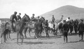 [Soldiers training on horses]