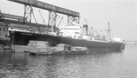 S.S. Huntsbook [at dock, with lumber-filled barges alongside]