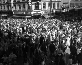 Crowds at Granville and Georgia after [1947 P.N.E.] opening day parade had passed