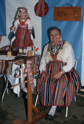 Olga Vesick, Estonian weaver at Heritage Showcase booth during the Centennial Commission's Canada...