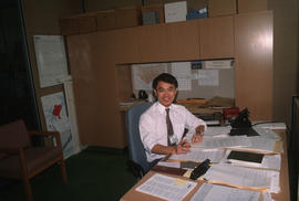 Paul Yee at his desk at the Archives of Ontario
