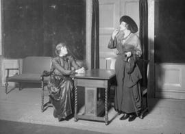Two women at a small table - possibly actors
