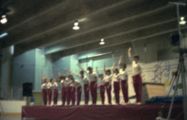 Youth bowing after gymnastics routine