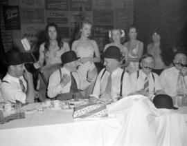 [Group of men and women entertaining Board of Trade members at a Christmas in June luncheon]
