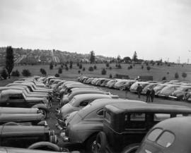 Cars parked by golf course
