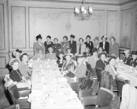 [Members of the Altrussa Club at a banquet]