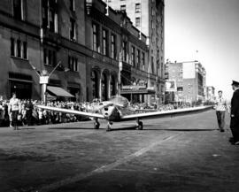 Taxiing airplane in 1947 P.N.E. Opening Day Parade