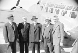 [Group portrait of men taken beside a Trans-Canada Air Lines plane]