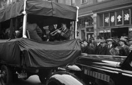 [A band in a truck on East Pender Street for funeral procession]