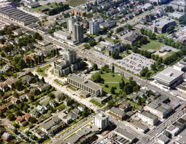 Aerial view of Vancouver City Hall and residential housing, facing southwest, at Cambie Street an...