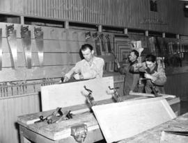[Men doing wood work in a] Calgary trade school