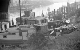 [Fishing boats and a shack under the Georgia Viaduct]