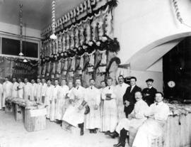 Group of butchers and a view of the interior of P. Burns & Co. Limited