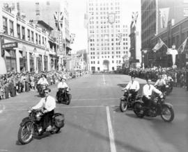 [Motorcyclists entertain spectators before the Diamond Jubilee Parade]