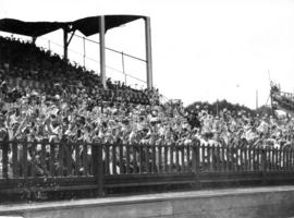 Crowd in Grandstand waving British flags