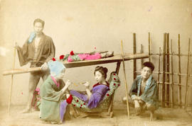 [Studio portrait of two men and two women in traditional Japanese dress]