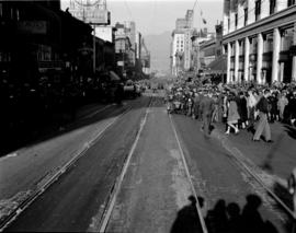 [Crowds along Granville Street waiting for military parade to pass by]