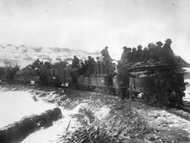 [Soldiers arrive by small train at the Western Front]