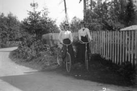 [Two women standing with bicycles in Stanley Park]