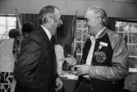 Unidentified man and Norman Young (right) laughing at Centennial birthday party