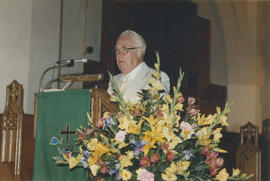 Unidentified man speaking from pulpit at St. Andrew's Wesley Church