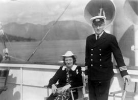[Unidentified officer and passenger (possibly Mrs. Elsie Halterman) on deck of Union Steamer]