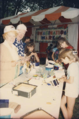 Children and grandparents at Imagination Market craft table