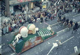 43rd Grey Cup Parade, on Granville Street, Welcome to Friendly Vancouver Grey Cup float, police o...
