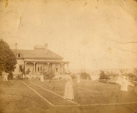 [Playing tennis on grass court at Benjamin Springer's residence]