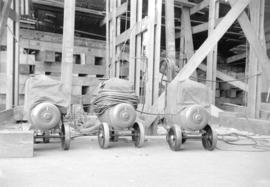[Three Lincoln welding machines at a shipyard shop]