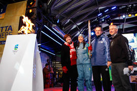 Torchbearer 96 Andrea Holmes on stage with Dignitaries in Vancouver, BC