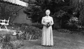 Harriet Banfield holding flowers at 5575 Angus Avenue