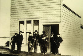 Group of men outside the Post Office on Hastings Street