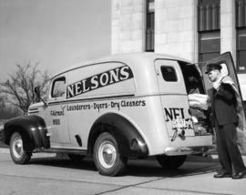 Nelson's Launderers & Dry Cleaners delivery man and delivery truck