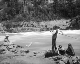 Indians catching salmon in the Fraser Canyon